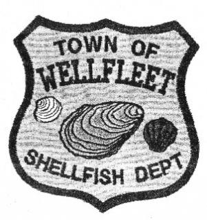 "Photo of Shellfish Badge with words ""Town of Wellfleet Shellfish Dept"""